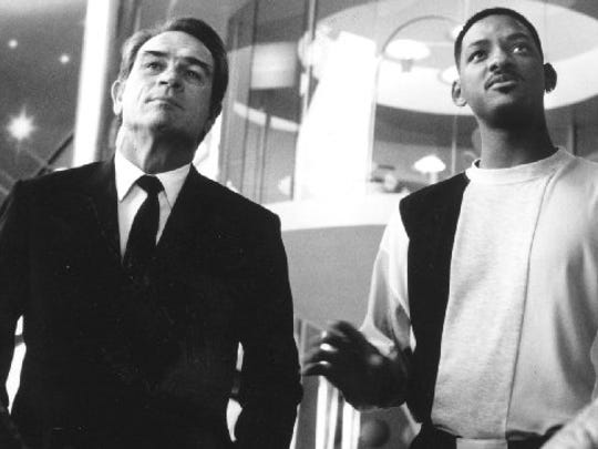 "Tommy Lee Jones (left) and Will Smith protect the Earth in  ""Men in Black"" (1997)."