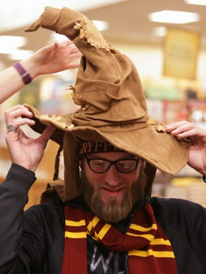 """Justine Time, 25, gets sorted by the sorting hat at the """"Harry Potter and the Cursed Child"""" release party held at the Barnes & Noble at the Keystone on July 30, 2016."""