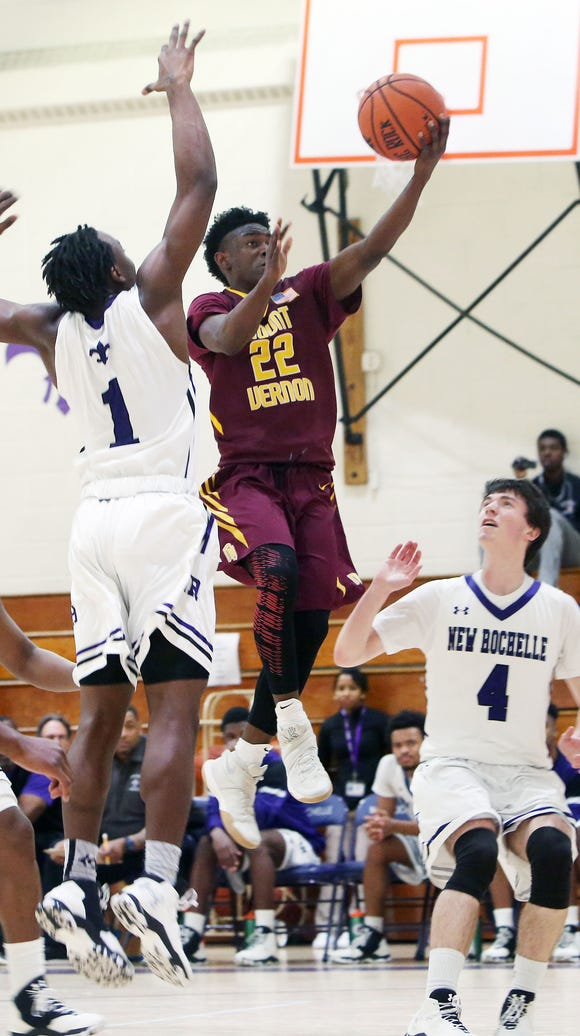 Mt. Vernon's Demetre Roberts (22) drives to the basket