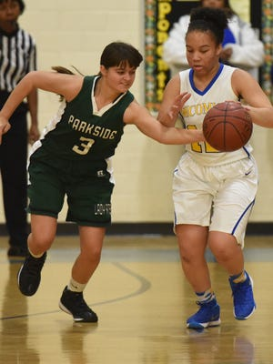 Parkside's Rachel Bratten takes the ball away from Wi-Hi's Alexis Phillips.