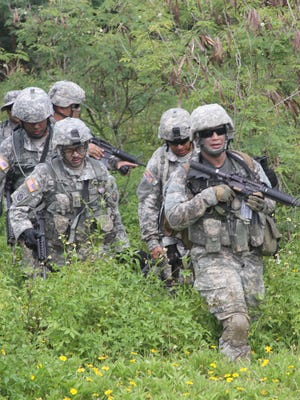 The Guam National Guard members take part in a training exercise in this undated file photo.