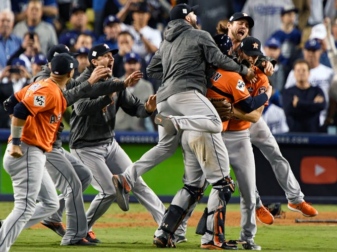 The Houston Astros celebrate after defeating the Los