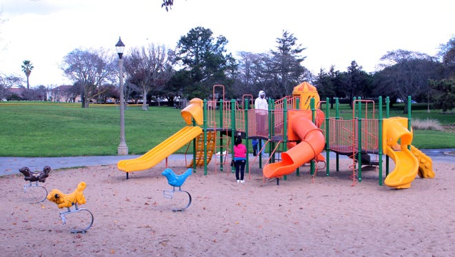 A family plays at the playground at El Dorado Park in this file photo.