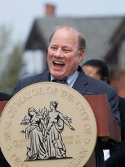 Detroit Mayor Mike Duggan talks to the media and neighbors at the press conference to announce the development partnership that will include 8.4 acres in the Brush Park neighborhood of Detroit.
