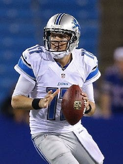 Detroit Lions quarterback Kellen Moore looks to pass against the Buffalo Bills during a preseason game at Ralph Wilson Stadium on Aug. 28, 2014.