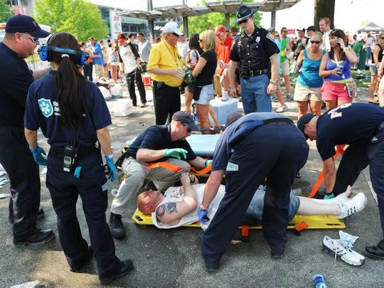 A drunk race fan is put onto a stretcher and taken to an ambulance at the plaza area at the end of Carb Day at the Indianapolis Motor Speedway on Friday, May 22, 2009. (Matt Detrich / The Star)