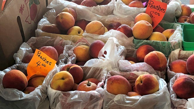 Baskets, bags and boxes of peaches were for sale by Wichita Falls area orchards Saturday morning at the Downtown Wichita Falls Farmers Market as part of its annual Peach Day.