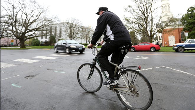 Salem resident Richard Villemyer rides his bike along Chemeketa Street on Friday, March 11, 2016, in downtown Salem. Villemyer said he rides his bike around town daily and often commutes to work that way. The City of Salem is working to make Salem a more bike-friendly place.