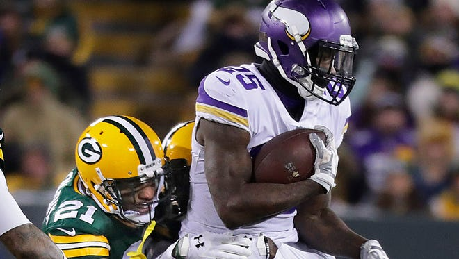 Green Bay Packers free safety Ha Ha Clinton-Dix can't stop Minnesota Vikings running back Latavius Murray from picking up a first down.