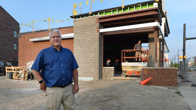 Pete Zaphiris, owner of Erie-based Great Lakes Insurance Services Group, stands in front of the new Citizens Bank branch office under construction at 25 W. 12th St. Zaphiris is also renovating the former Citizens Bank building at 12th and State streets.