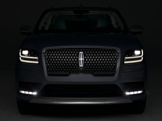 Glowing Lincoln emblem on grille