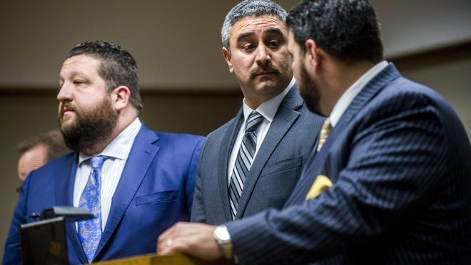 Daugherty Johnson, center, Flint's former utilities administrator, pleaded no contest Tuesday to a misdemeanor public records charge rather than facing two felony charges at Genesee District Court in downtown Flint.