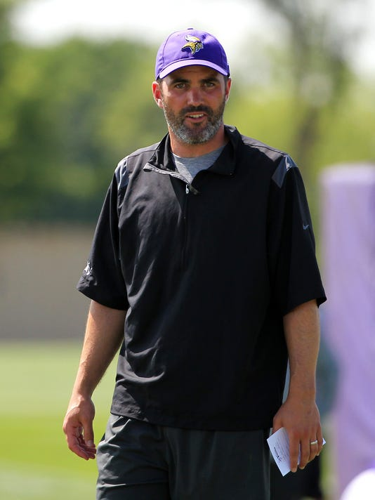 Minnesota Vikings quarterback coach Kevin Stefanski watches practice during an NFL football training camp Thursday, July 27, 2017, in Mankato, Minn. Stefanski is the longest-tenured member of the coaching staff, dating back 12 years when he joined the organization as an office assistant to former coach Brad Childress. Now he is in charge of the quarterbacks, his fourth different job for his third different coach in the organization. (AP Photo/Andy Clayton-King)