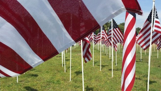 "This Daily Times file photo shows some of the 500 flags erected in a ""Field of Honor"" along Hobbs Road at the intersection of Route 50 in Salisbury. A Memorial Day Flags for Heroes dedication of the field of red, white and blue is canceled because of heavy rain. The display is sponsored by Rotary clubs of Wicomico County."