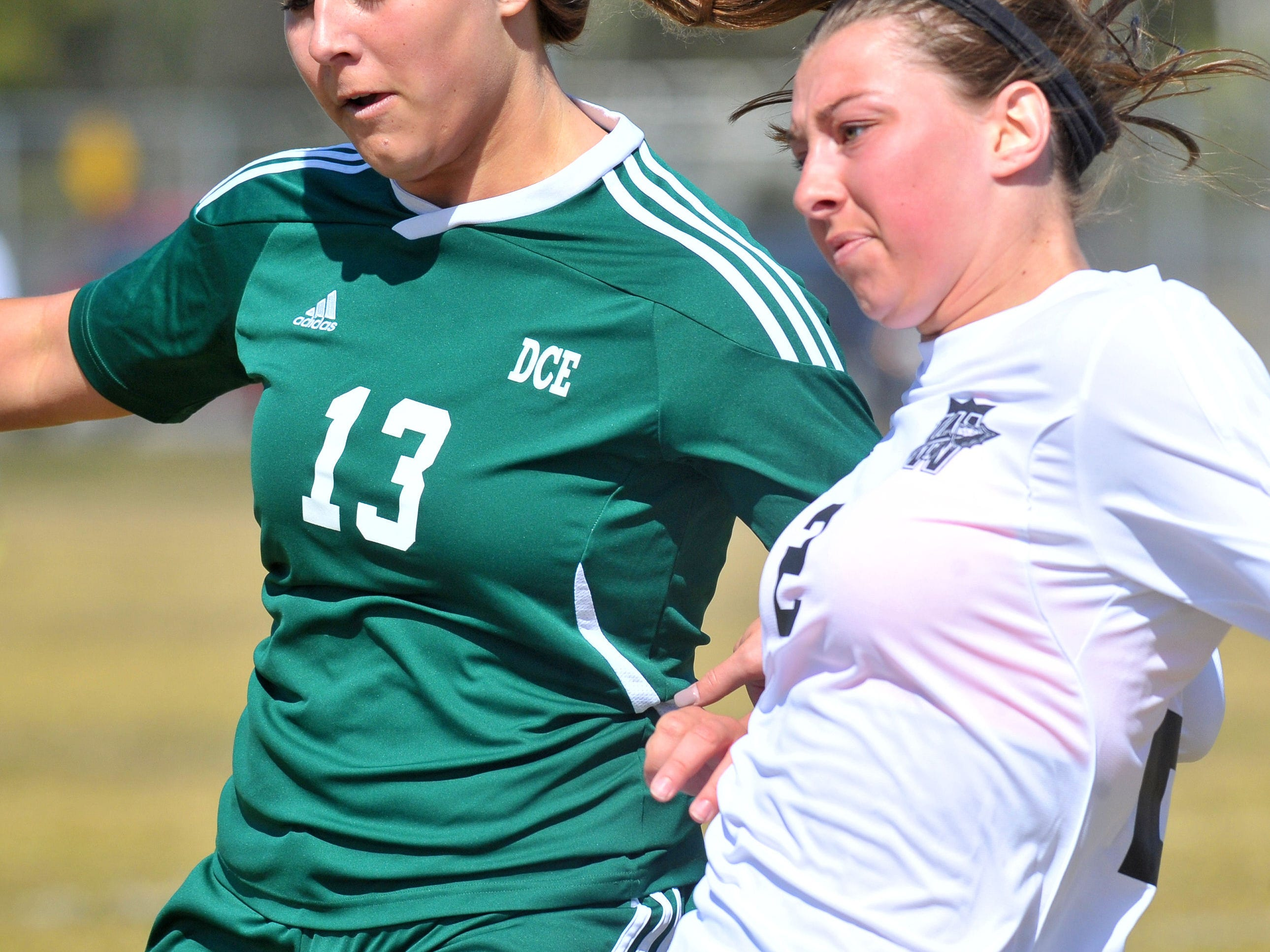 Everest's Krista Koenig, left, and Waunakee's Karly Keller battle for the ball during the first half Saturday.