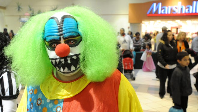 William Gonzalez, 38, of Vineland, trick-or-treats as a scary clown during a Halloween celebration at the Cumberland Mall on Saturday, October 29, 2011.
