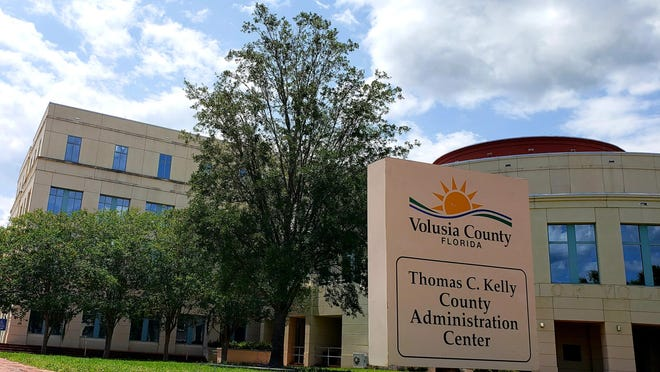 The live oak that previously stood outside the Thomas C. Kelly County Administration Center was removed in 2019 due to fungal issues. A county tradesworker transformed part of the old tree's trunk into a rustic bench that will be unveiled Wednesday, June 3, 2020, underneath the shade of the tree that took its place.
