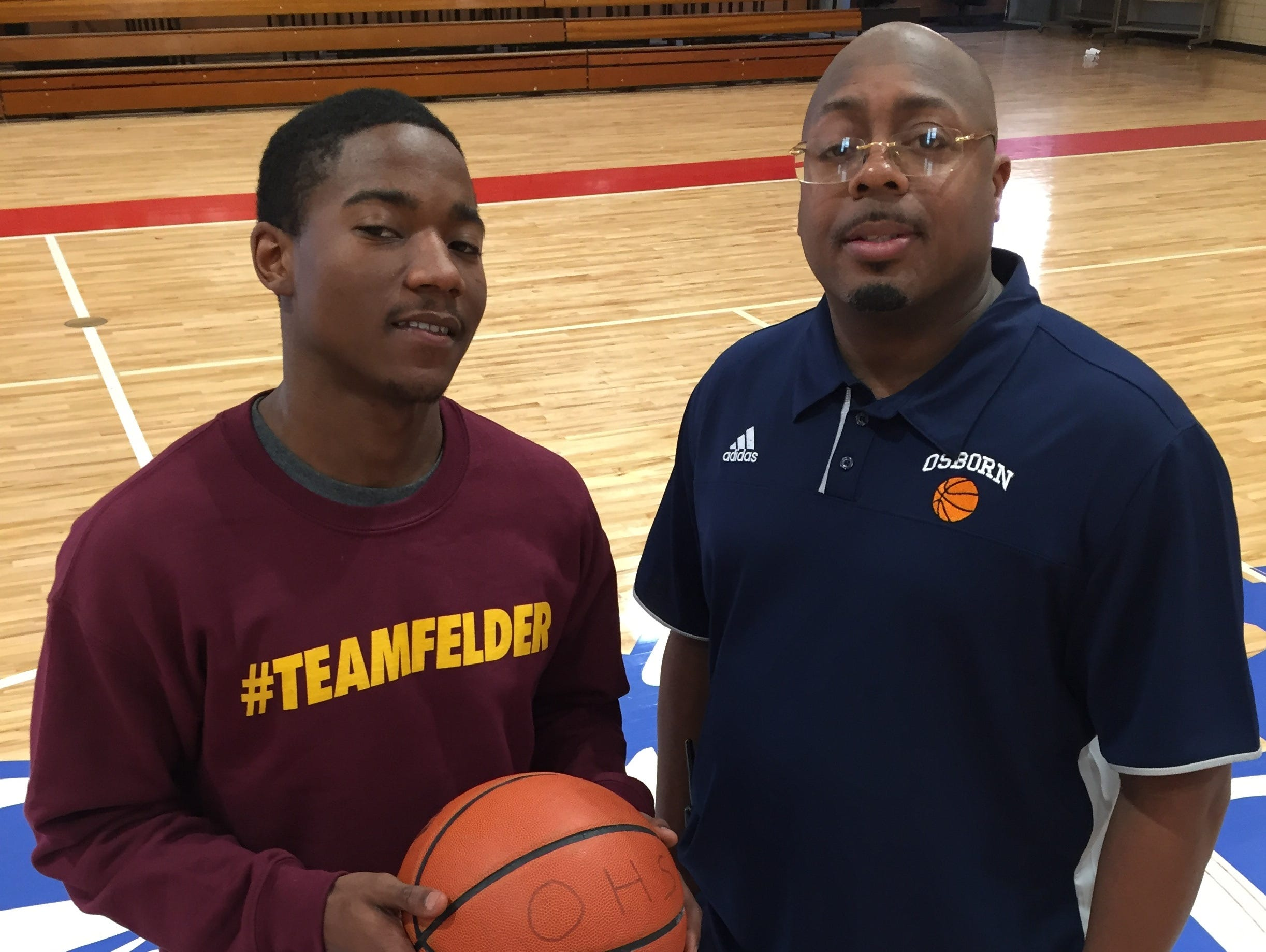Detroit Osborn senior guard Armonee Felder, left, poses for a picture with coach Lonell Williams at Osborn on Friday, March 3, 2017.