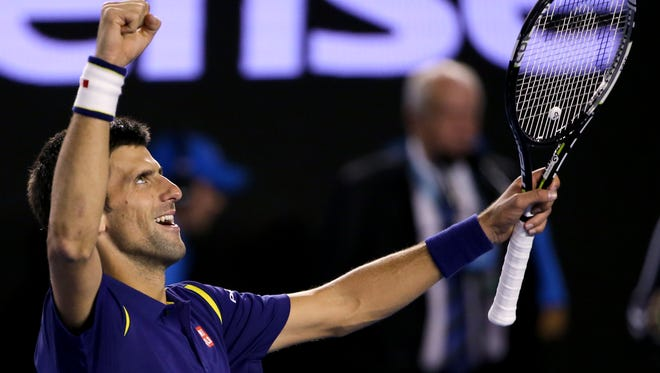 Novak Djokovic of Serbia celebrates after defeating Andy Murray of Britain in the men's singles final at the Australian Open tennis championships in Melbourne, Australia, Sunday.