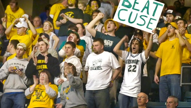 Catamount fans cheer during the second half of Vermont's 60-57 overtime victory over Syracuse in the first round of the NCAA Tournament at the DCU Center in Worcester, Mass. on March 18, 2005.