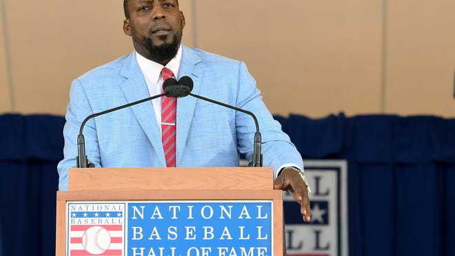National Baseball Hall of Fame inductee Vladimir Guerrero speaks during an induction ceremony at the Clark Sports Center on Sunday, July 29, 2018, in Cooperstown, N.Y. (AP Photo/Hans Pennink)