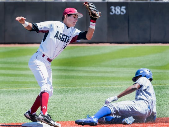 New Mexico State third baseman Joey Ortiz tries to