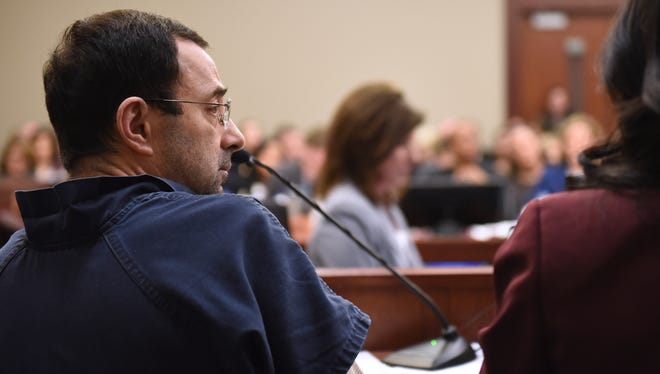 Larry Nassar sits in court during a sentencing hearing Jan. 18 during the third day of victim impact statements in Lansing, Mich.