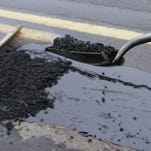 Salem Public Works Director Peter Fernandez told the budget committee that the primary funding sources for street repairs are insufficient to keep pace with maintenance needs. Asphalt is shoveled over hot tar to form a patch over a pothole on Airport Road, between State and Mission streets, on Jan. 26, 2006. More than 500 potholes have shown up in January alone.