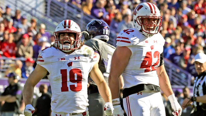 Wisconsin Badgers safety Leo Musso (left) cheers with teamate T.J. Watt during their game against Northwestern.