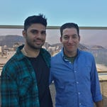 In this undated photo released by Janine Gibson of The Guardian, Guardian journalist Glenn Greenwald, right, and his partner David Miranda are shown together at an unknown location.