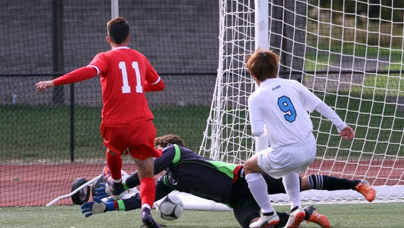Goalkeeper Guillermo Pons of Rye Neck gets to the ball