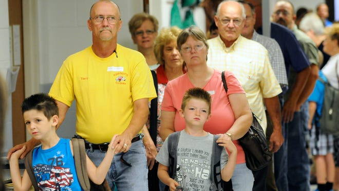 Grandparents and students at Niagara Elementary wait in line, early Friday morning, for the school's annual grandparents' breakfast in this file photo from Sept. 6, 2013.