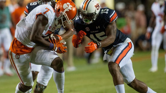 Auburn defensive back Joshua Holsey (15) tackles Clemson wide receiver Mike Williams (7) after a reception at Jordan-Hare Stadium in Auburn, Ala., on Saturday September 3, 2016.
