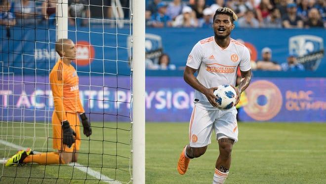Montreal Impact goalkeeper Evan Bush looks on after being scored against by Atlanta United's Josef Martinez.