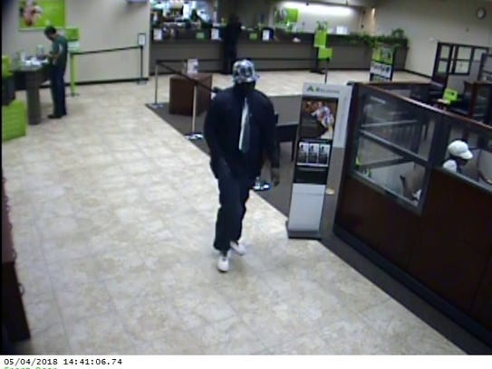 Surveillance video photo of Regions Bank robbery suspect.