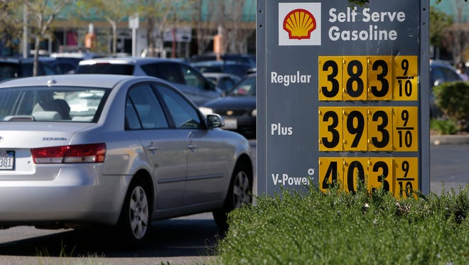 Gas prices are displayed at a Shell station in Sacramento, Calif., in March 2014.