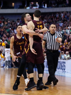 Loyola-Chicago Ramblers guard Clayton Custer (13) celebrates with teammates after hitting the game-winning shot to defeat the Tennessee Volunteers in the second round of the 2018 NCAA Tournament at American Airlines Center.
