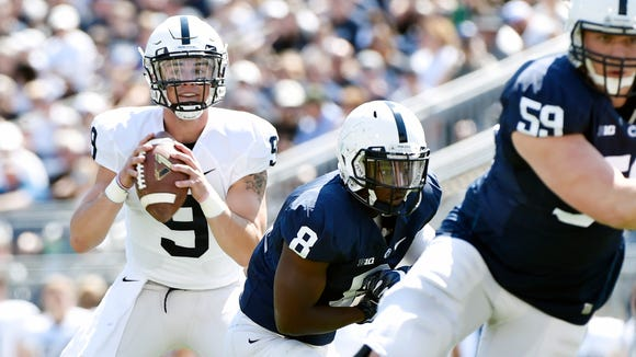 Penn State quarterback Trace McSorley looks to pass the ball in the first half of Penn State's spring football scrimmage, the Blue-White Game, Saturday, April 16, 2016, in State College. The blue squad won 37-0.