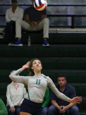 Fort Myers senior Alayna Ryan goes to spike the ball during a Sept. 12 game against Seacrest Country Day.