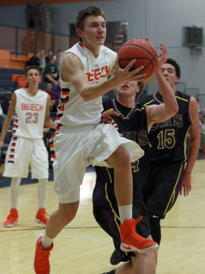 Beech's A.J. Robertson glides to the hoop during Tuesday's game against Clarksville.