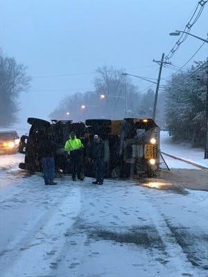 South Brunswick sand truck overturns on Beekman Road during the Wednesday morning snow.