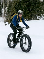 Topher Mason riding his Surly snow bike around Deer Valley up in Cedar Canyon.