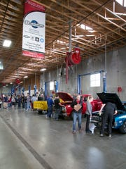 Southwest Applied Technology College Automotive Center held a car show on Friday. Automotive Technology instructor Richard Wittwer said another aspect of the open house is to bring alumni back into the building and simply talk cars.