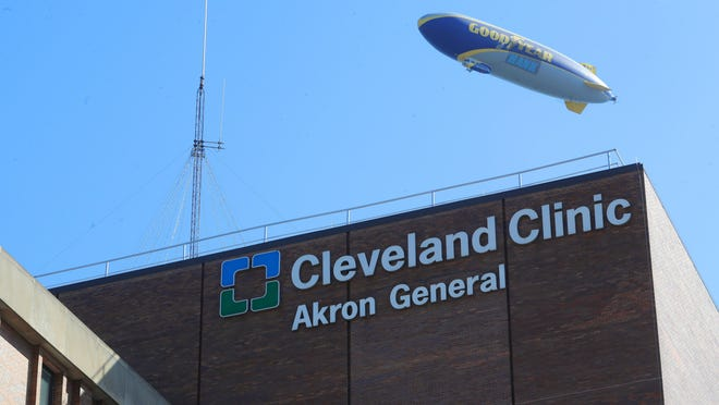 The Goodyear blimp flies over Cleveland Clinic Akron General campus on Tuesday, June 16, 2020, Akron, Ohio.