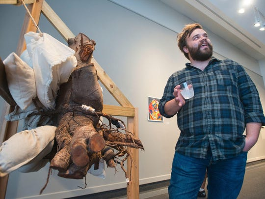 """Artist Corey Frey discusses his work during the """"SynThesis"""" Bachelor of Fine Arts exit show at The Art Gallery at the University of West Florida in Pensacola on Thursday, April 20, 2017."""
