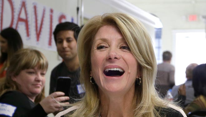 Texas Sen. Wendy Davis, D-Fort Worth, laughs as she visits with supporters at her campaign headquarters March 4.