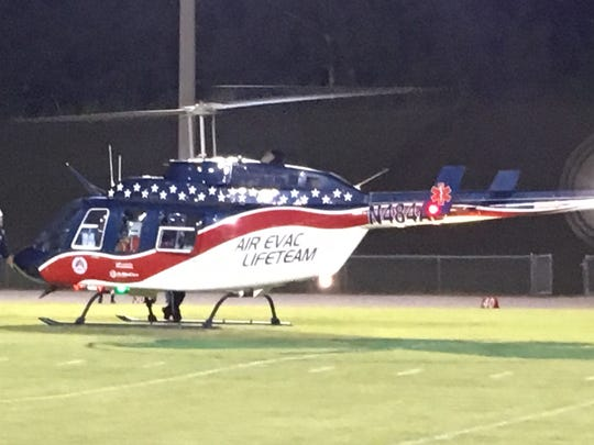 An Air Evac medical helicopter out of McEwen made a special delivery of a game ball signed by Tennessee Titans players to kickoff the Houston County High School 2017 Homecoming football game.