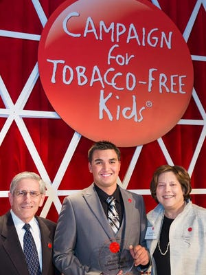 Spencer Flanders receives his award as National Youth Advocate of the Year by the Campaign for Tobacco-Free Kids.