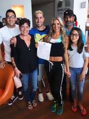 FGCU cheerleader Zahra Fayad stands with her family after making the Miami Dolphins cheer squad April 22, 2018.
