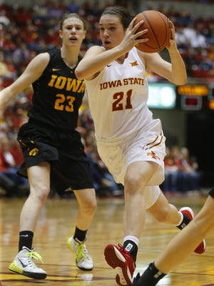 Iowa State's Bridget Carleton drives the ball past Iowa's Christina Buttenham during the Cy-Hawk women's basketball game at Hilton Coliseum in Ames on Friday.